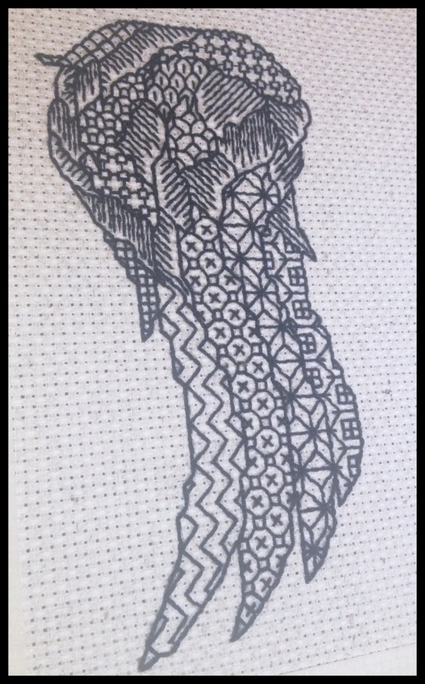 Current stitching project from a pattern of my own design.  Exactly halfway done.